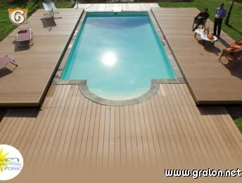 Photo couverture mobile de piscine abri plat pooldeck for Piscine couverture mobile